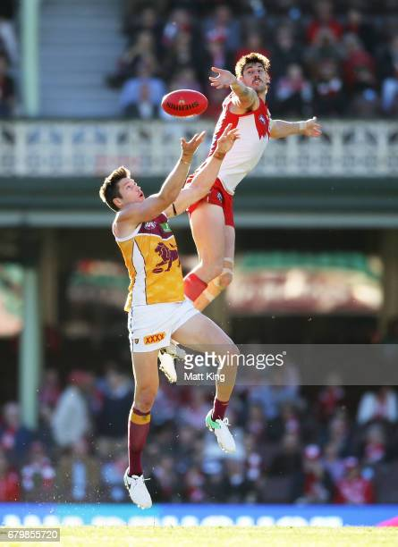 Sam Naismith of the Swans is challenged by Stefan Martin of the Lions during the round seven AFL match between the Sydney Swans and the Brisbane...