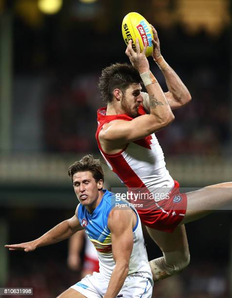 Sam Naismith of the Swans marks over David Swallow of the Suns during the round 16 AFL match between the Sydney Swans and the Gold Coast Suns at...