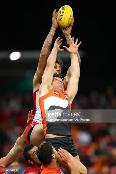 Sam Naismith of the Swans marks over Toby Greene of the Giants during the round 17 AFL match between the Greater Western Sydney Giants and the Sydney...