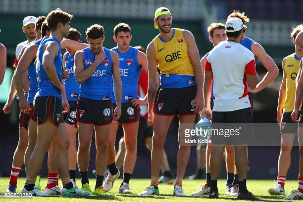 Sam Naismith shares a laugh with a team mate as they listen to instructions during a Sydney Swans AFL training session at Sydney Cricket Ground on...