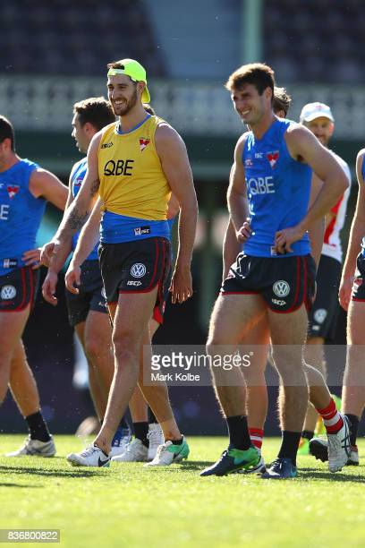 Sam Naismith shares a laugh with a team mate during a Sydney Swans AFL training session at Sydney Cricket Ground on August 22 2017 in Sydney Australia