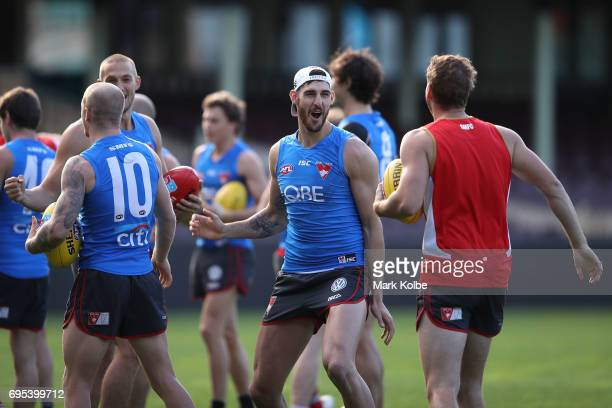 Sam Naismith shares a laugh with his team mates during a Sydney Swans AFL training session at Sydney Cricket Ground on June 13 2017 in Sydney...