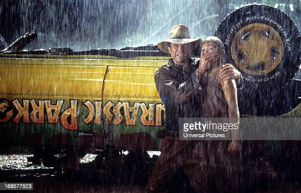 Sam Neill covers the mouth of Ariana Richards in a scene from the film 'Jurassic Park' 1993