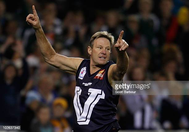 Sam Newman celebrates after kicking a goal during the 2010 EJ Whitten Legends AFL Game between Victoria and the All Stars at Etihad Stadium on July 6...