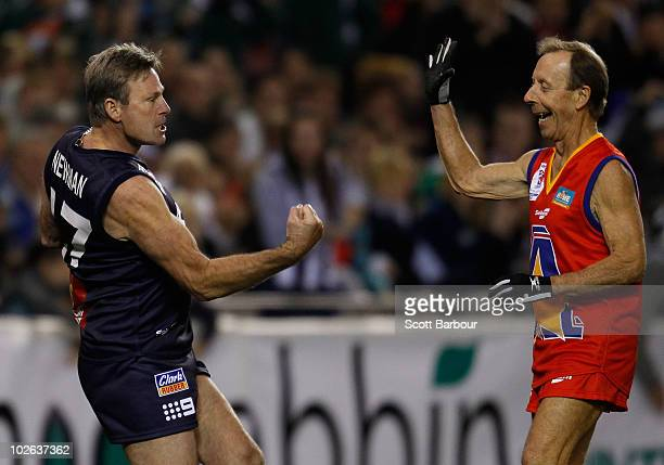 Sam Newman of Victoria celebrates after kicking a goal as Cobber Rogers of the All Stars looks on during the 2010 EJ Whitten Legends AFL Game between...