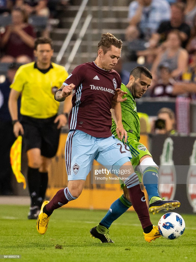 Sam Nicholson #28 of Colorado Rapids and Victor Rodriguez #8 of Seattle Sounders battle for possession at Dick's Sporting Goods Park on July 4, 2018 in Commerce City, Colorado.