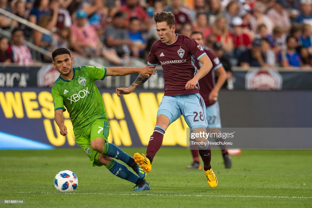 Sam Nicholson #28 of Colorado Rapids attempts a pass past Cristian Roldan #7 of Seattle Sounders at Dick's Sporting Goods Park on July 4, 2018 in Commerce City, Colorado.