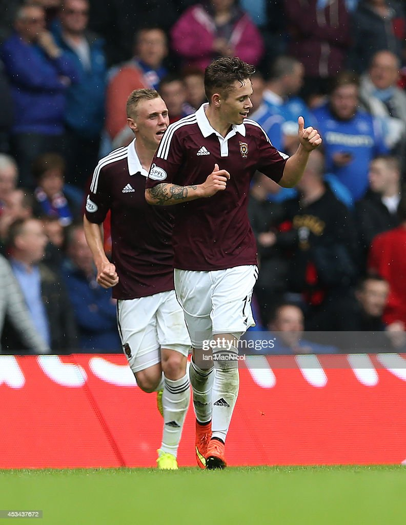 Sam Nicholson of Hearts celebrates his goal during the Scottish Championship Opening League Match between Rangers and Hearts, at Ibrox Stadium on August 10, 2014 Glasgow, Scotland.