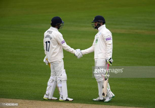 Sam Northeast and Rilee Rossouw of Hampshire shake hands after sharing a century partnership during Day One of the Specsavers County Champions...