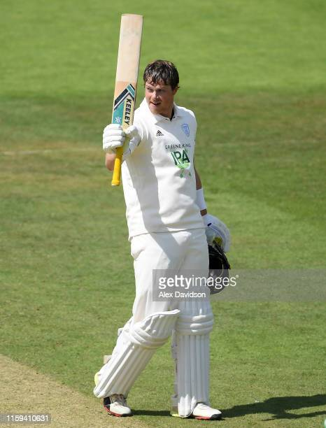 Sam Northeast of Hampshire celebrates reaching his century during Day Two of the Specsavers County Championship Division One match between Somerset...
