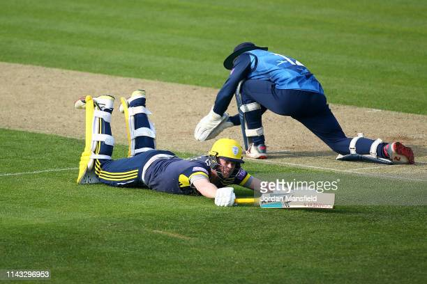 Sam Northeast of Hampshire dives to make his ground during the Royal London One Day Cup match between Kent and Hampshire at The Spitfire Ground on...