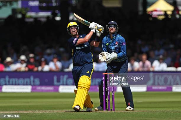 Sam Northeast of Hampshire hits a six as Kent captain Sam Billings looks on during the Royal London OneDay Cup Final match between Kent and Hampshire...