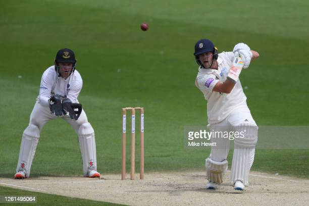 Sam Northeast of Hampshire in action as wicketkeeper Ben Brown of Sussex looks on during a friendly match between Sussex and Hampshire at County...