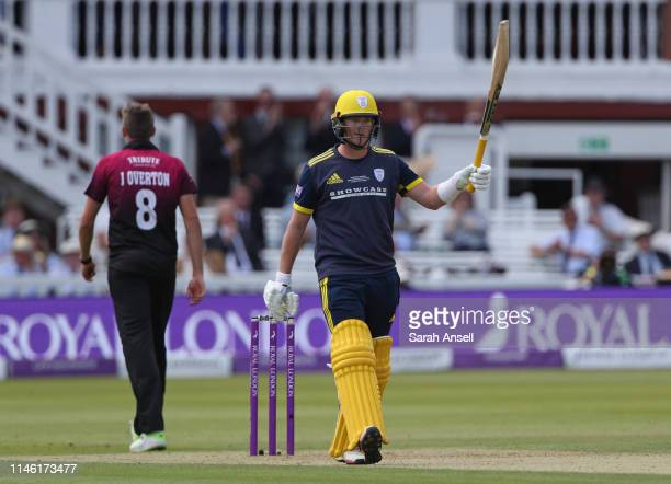 Sam Northeast of Hampshire raises his bat after reaching a half century during the Royal London One Day Cup Final match between Somerset and...