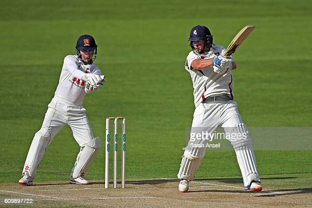 Sam Northeast of Kent cuts the ball to the boundary as Essex wicket keeper Adam Wheater looks on during day 4 of the Specsavers County Championship...