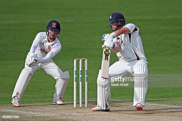 Sam Northeast of Kent hits a boundary as Essex wicket keeper Adam Wheater looks on during day 4 of the Specsavers County Championship Division 2...