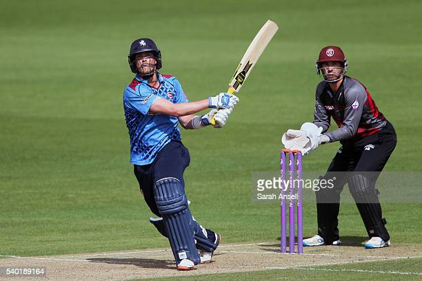 Sam Northeast of Kent hits out as Somerset wicket keeper Alex Barrow looks on during The Royal London OneDay Cup match between Kent and Somerset at...