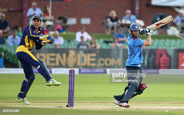 Sam Northeast of Kent hits out while Mark Wallace of Glamorgan hits out during Royal London OneDay Cup match between Kent Spitfires and Glamorgan at...