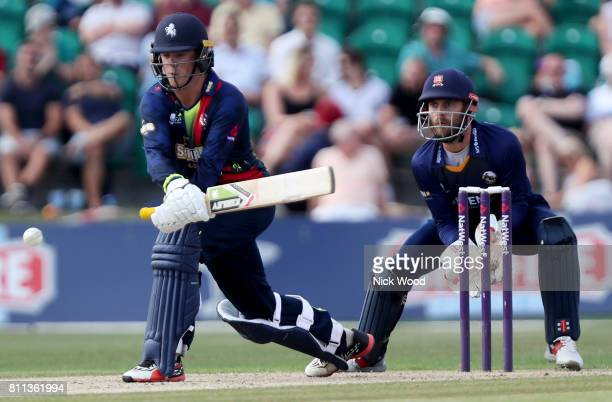 Sam Northeast of Kent prepares to sweep whilst batting during the Kent Spitfires v Essex Eagles NatWest T20 Blast cricket match at the County Ground...