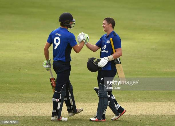 Sam Northeast of The South celebrates his century with Ben Foakes during Game Two of the ECB North versus South Series at Dubai International Cricket...