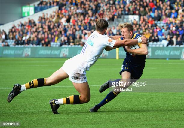 Sam Olver of Worcester Warriors is tackled by Josh Bassett of Wasps during the Aviva Premiership match between Worcester Warriors and Wasps at...