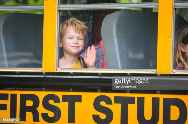 sam on his school bus on his last day of kindergarten - dan sherwood photography stock pictures, royalty-free photos & images