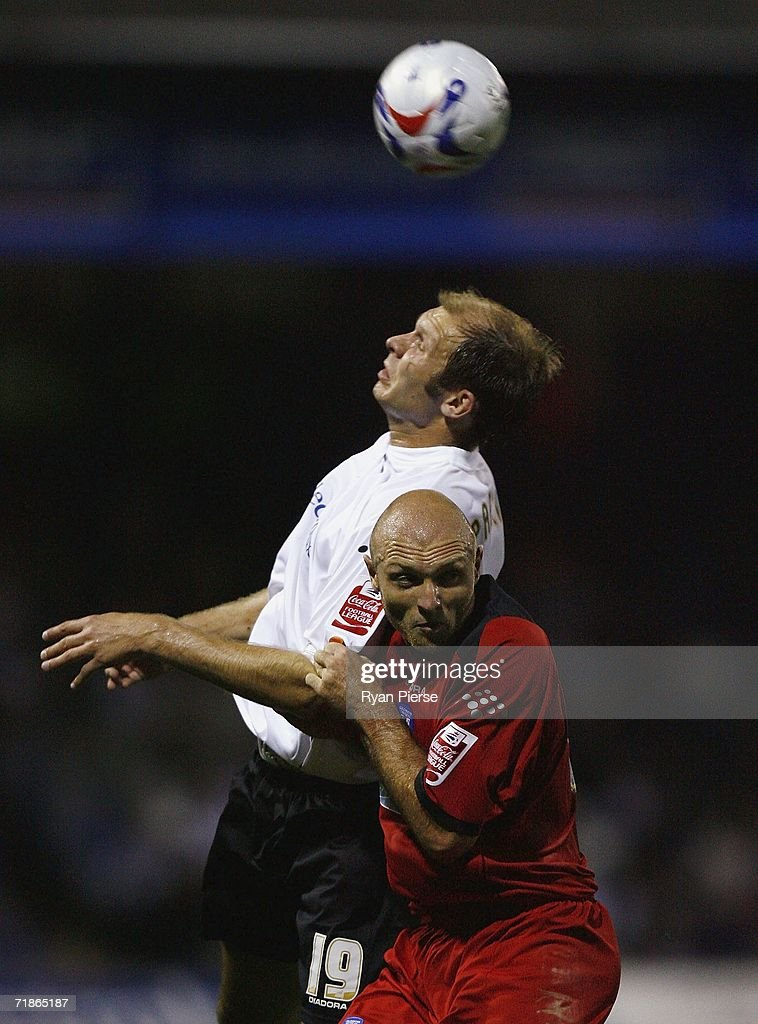 Sam Parkin (L) of Luton contests a high ball against Wayne Brown (R) of Colchester during the Coca Cola Championship match between Luton Town and Colchester United at Kenilworth Road on September 12, 2006 in Luton, England.