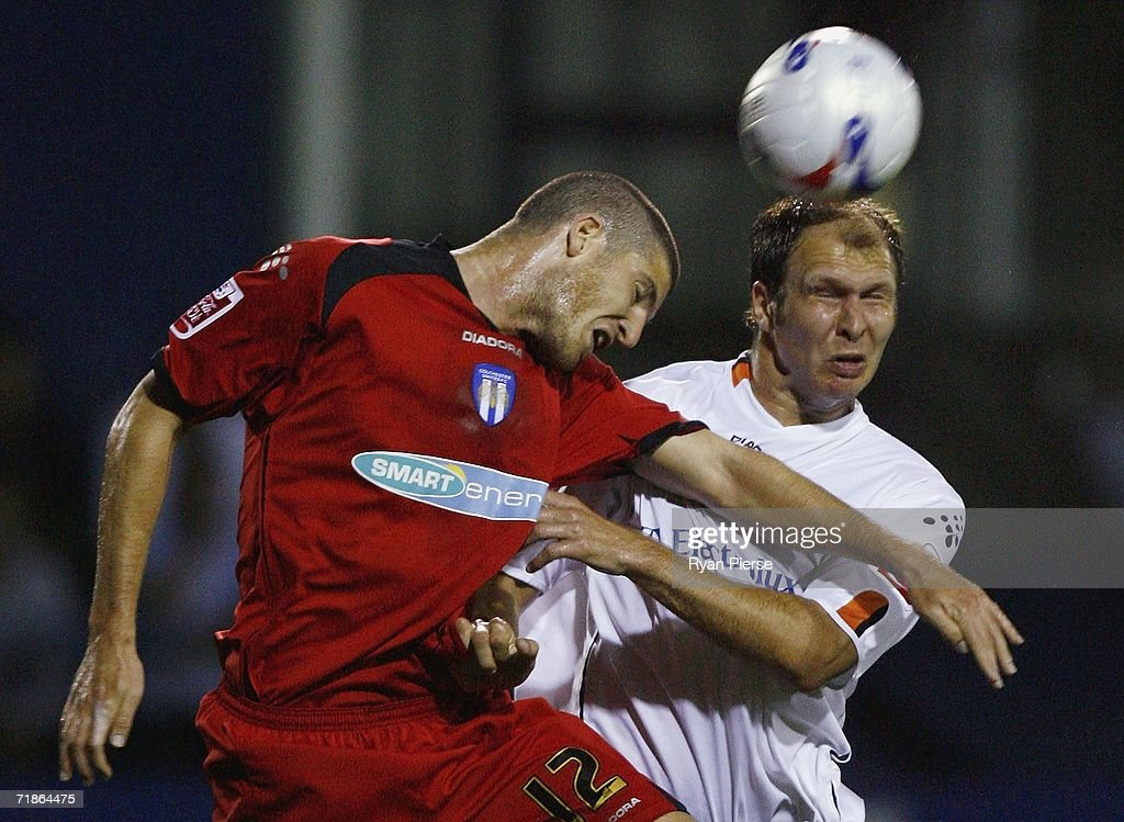 Sam Parkin (R) of Luton Town heads in his teams first goal past Pat Baldwin (L) of Colchester United during the Coca Cola Championship match between Luton Town and Colchester United at Kenilworth Road on September 12, 2006 in Luton, England.