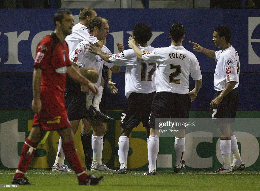 Sam Parkin of Luton Town is congratulated by team mates after scoring his teams first goal during the Coca Cola Championship match between Luton Town and Colchester United at Kenilworth Road on September 12, 2006 in Luton, England.