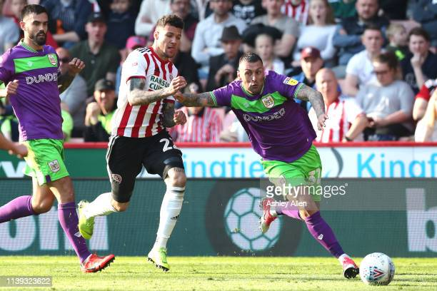 Sam Pearson of Bristol City keeps possession from Marvin Johnson of Sheffield United during the Sky Bet Championship match between Sheffield United...