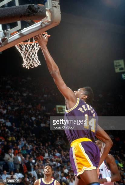 Sam Perkins of the Los Angeles Lakers goes in for a layup against the Washington Bullets during an NBA basketball game circa 1991 at the Capital...