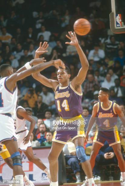 Sam Perkins of the Los Angeles Lakers in action against the Washington Bullets during an NBA basketball game circa 1991 at the Capital Centre in...