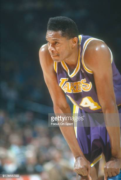 Sam Perkins of the Los Angeles Lakers looks on against the Washington Bullets during an NBA basketball game circa 1991 at the Capital Centre in...