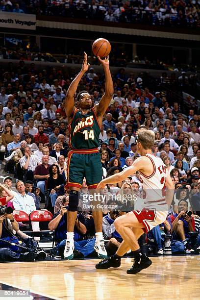 Sam Perkins of the Seattle SuperSonics shoots a jump shot over Steve Kerr of the Chicago Bulls during Game Six of the 1996 NBA Finals at the United...