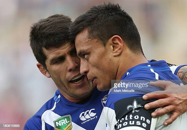 Sam Perrett of the Bulldogs celebrates with team mate Michael Ennis after scoring a try during the NRL Elimination Final match between the Canterbury...