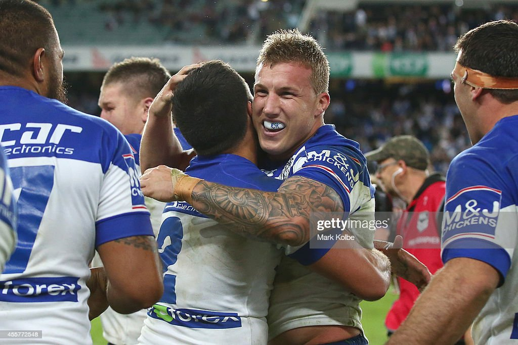 Sam Perrett of the Bulldogs embraces Trent Hodkinson of the Bulldogs as they celebrate victory after Trent Hodkinson kicked the winning field goal in extra time golden point during the NRL 2nd Semi Final match between the Manly Sea Eagles and the Canterbury Bulldogs at Allianz Stadium on September 20, 2014 in Sydney, Australia.