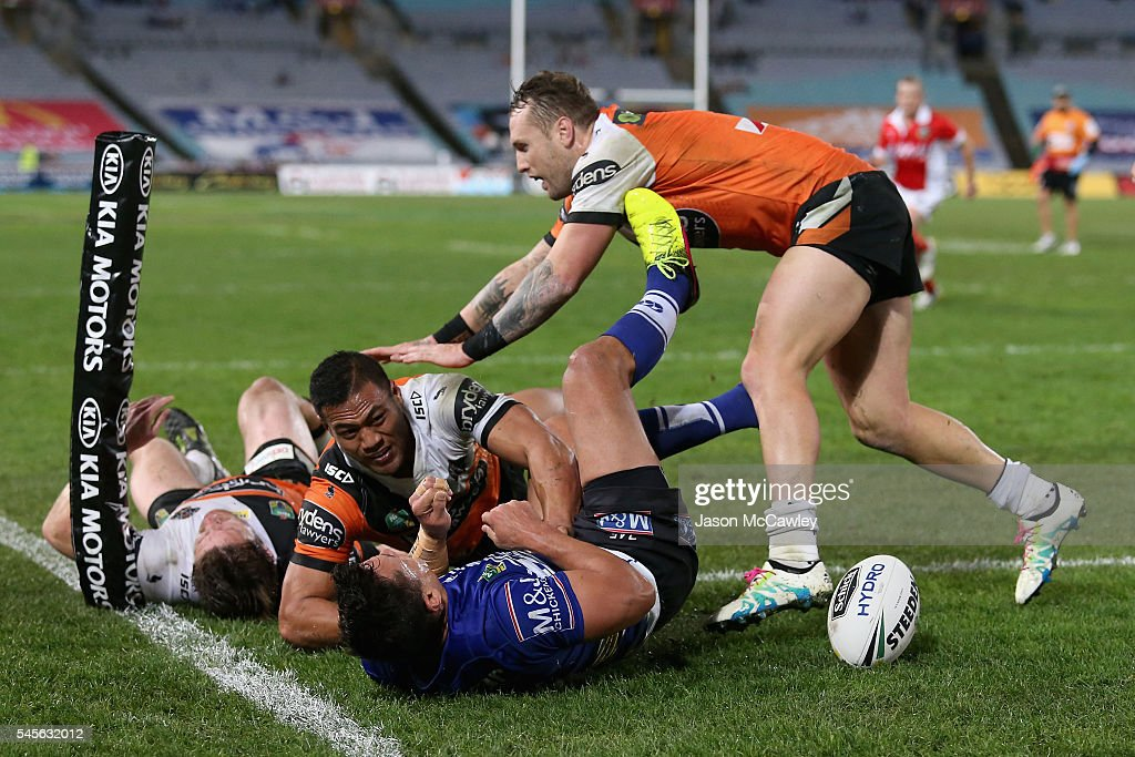Sam Perrett of the Bulldogs scores a try during the round 18 NRL match between the Canterbury Bulldogs and the Wests Tigers at ANZ Stadium on July 9, 2016 in Sydney, Australia.