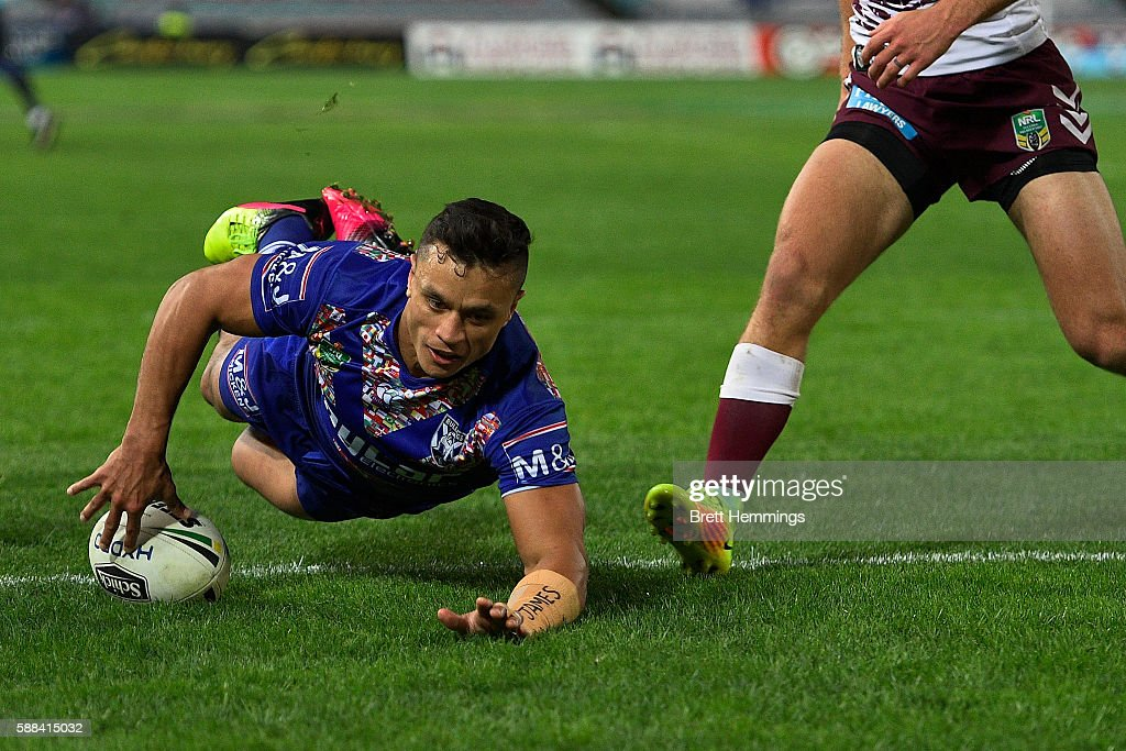 Sam Perrett of the Bulldogs scores a try during the round 23 NRL match between the Canterbury Bulldogs and the Manly Sea Eagles at ANZ Stadium on August 11, 2016 in Sydney, Australia.