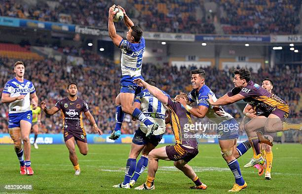 Sam Perrett of the Bulldogs takes a catch during the round 22 NRL match between the Brisbane Broncos and the Canterbury Bulldogs at Suncorp Stadium...
