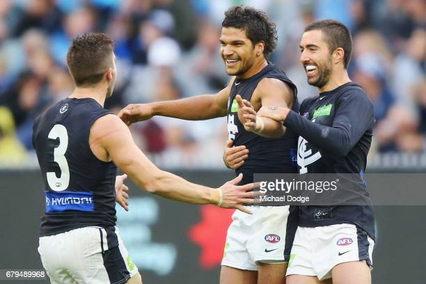 Sam PetrevskiSeton of the Blues celebrates a goal with Marc Murphy and Kade Simpson during the round seven AFL match between the Collingwood Magpies...