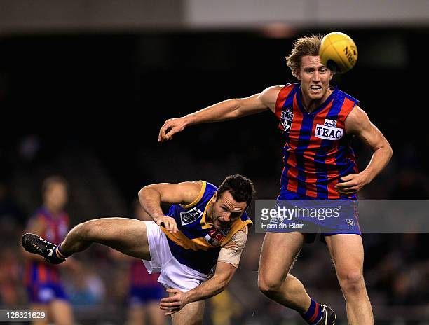 Sam Pleming of Port Melbourne contests with Matthew Cravino of Williamstown during the VFL Grand Final match between Port Melbourne and Williamstown...