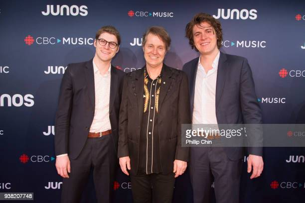 Sam Polley Jim Cuddy and Devin Cuddy attend the red carpet arrivals at the 2018 Juno Awards at Rogers Arena on March 25 2018 in Vancouver Canada