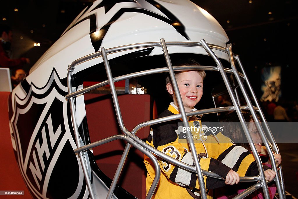 Sam Pollock, the son of NHL referee Kevin Pollock, pose inside a giant helmet inside the NHL Fan Fair part of 2011 NHL All-Star Weekend at the Raleigh Convention Center on January 28, 2011 in Raleigh, North Carolina.
