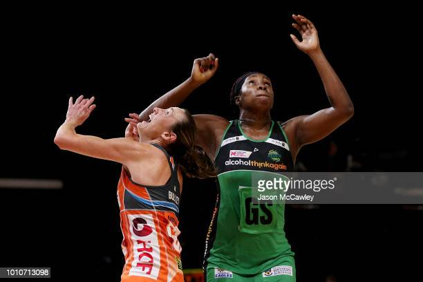Sam Poolman of the Giants and Jhaniele Fowler of the Fever compete for the ball during the round 14 Super Netball match between the Giants and the...