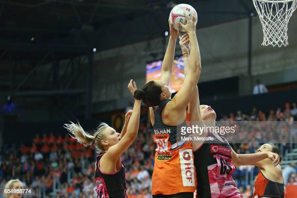 Sam Poolman of the Giants and Karyn Bailey of the Thunderbirds contest possession during the round five Super Netball match between the Giants and...