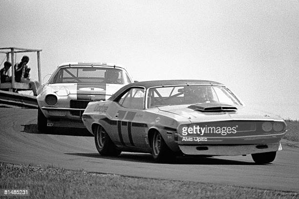 Sam Posey's Dodge Charger leads Jim Hall's Chaparral Camero in the Trans Am race held June 6 1970 on the MidOhio track near Lexington Ohio