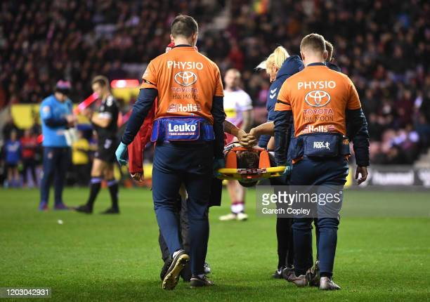 Sam Powell of Wigan is stretchered off following an injury during the Betfred Super League match between Wigan Warriors and Warrington Wolves at DW...