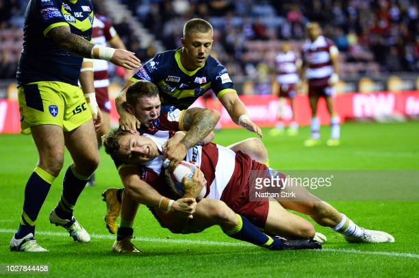 Sam Powell of Wigan scores their second try during the BetFred Super League match between Wigan Warriors and Wakefield Trinity on September 6 2018 in...