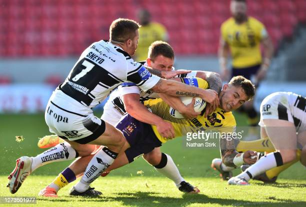 Sam Powell of Wigan Warriors score the first try of the game during the Coral Challenge Cup Quarter Final match between Hull FC and Wigan Warriors at...