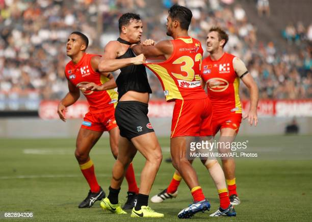 Sam PowellPepper of the Power and Aaron Hall of the Suns wrestle during the 2017 AFL round 08 match between the Gold Coast Suns and Port Adelaide...